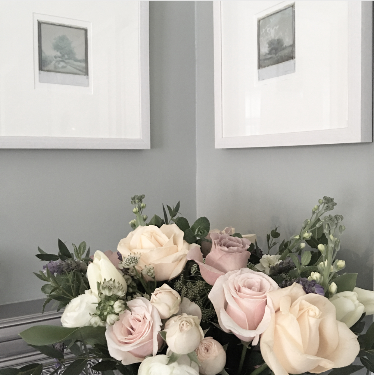The New Neutrals: In the #MOhome main bedroom, the walls are painted in Farrow & Ball's 'Light Blue'; the headboard is tiled with H&E Smith Victorian tiles; and the flowers are from The Real Flower Company. Framed Polaroid artwork by Nathan Pendlebury (erpenstudios.co.uk)