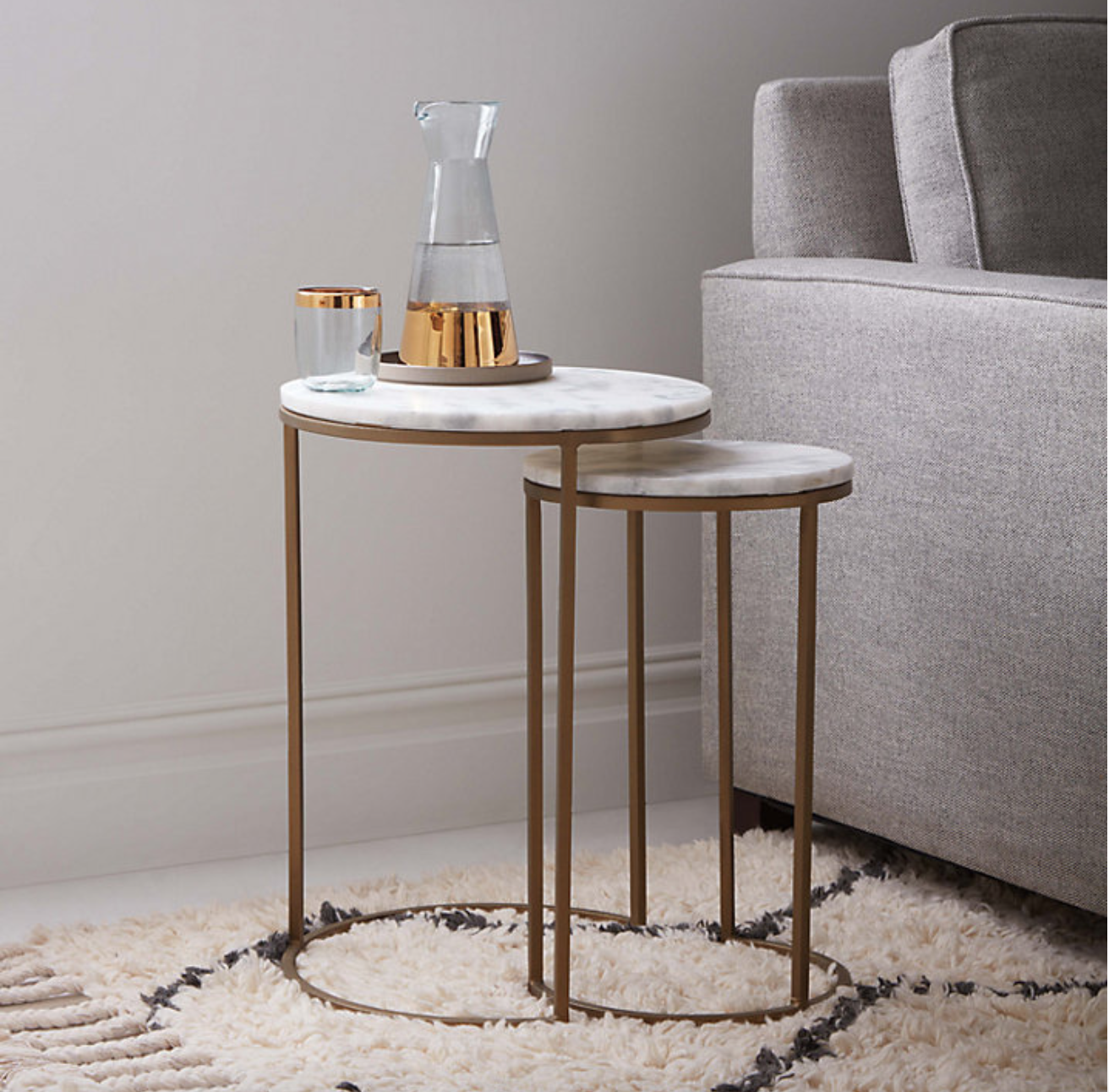 Pair of West Elm marble-topped round nesting tables, with antique brass base, £349 from John Lewis.