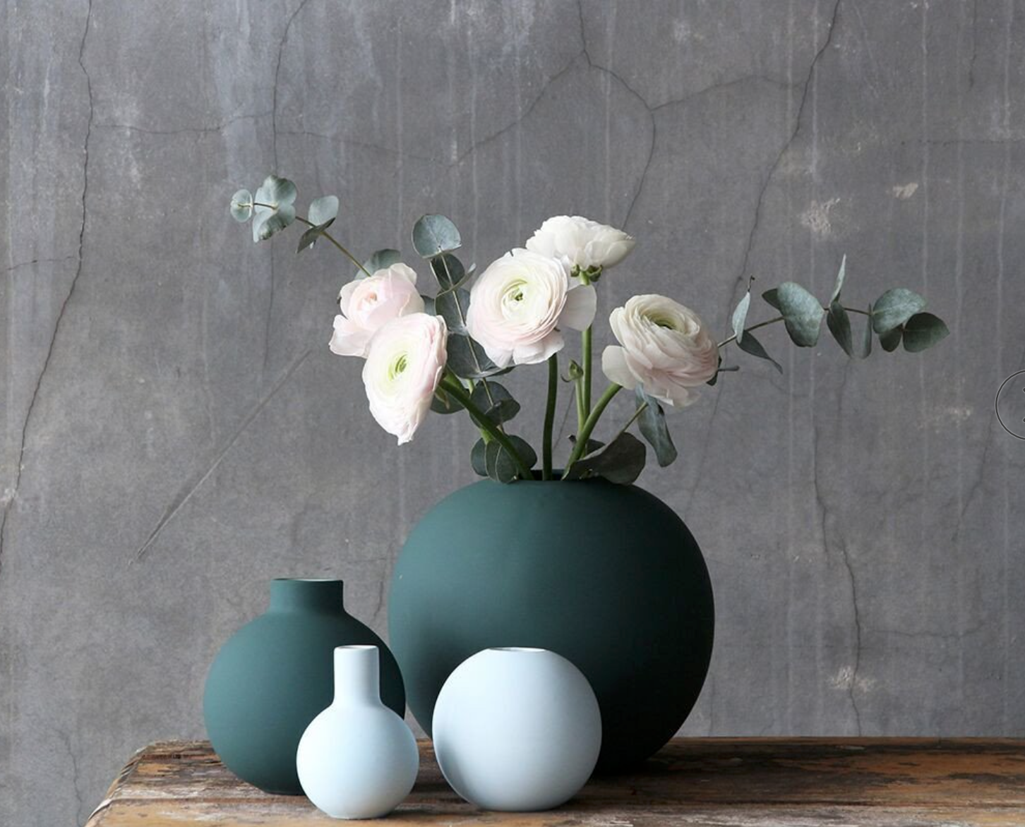 Hand made ceramic Ball vase, 20cm diameter, by Cooee Design in dark matt finish fir green.