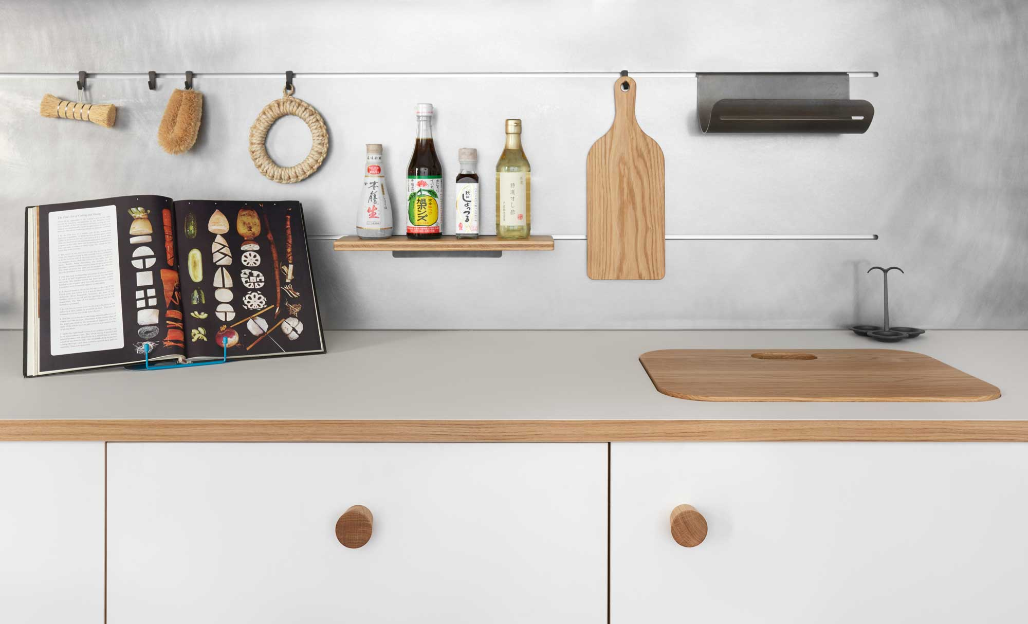 The 'Lepic' kitchen designed by Jasper Morrison for Schiffini. Finished in oak wood and a solid sheet laminate called Fenix. All kitchen accessories (hanging rails, shelving, chopping boards etc) designed by Jasper.