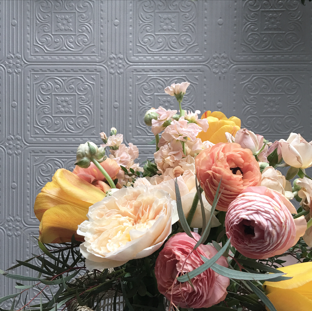 The New Neutrals plus mustard is THE colour combination of the season. A calm backdrop with a pop of unexpected, yet super complementary, colour. Flowers by The Real Flower Company. Photograph: Michelle Ogundehin