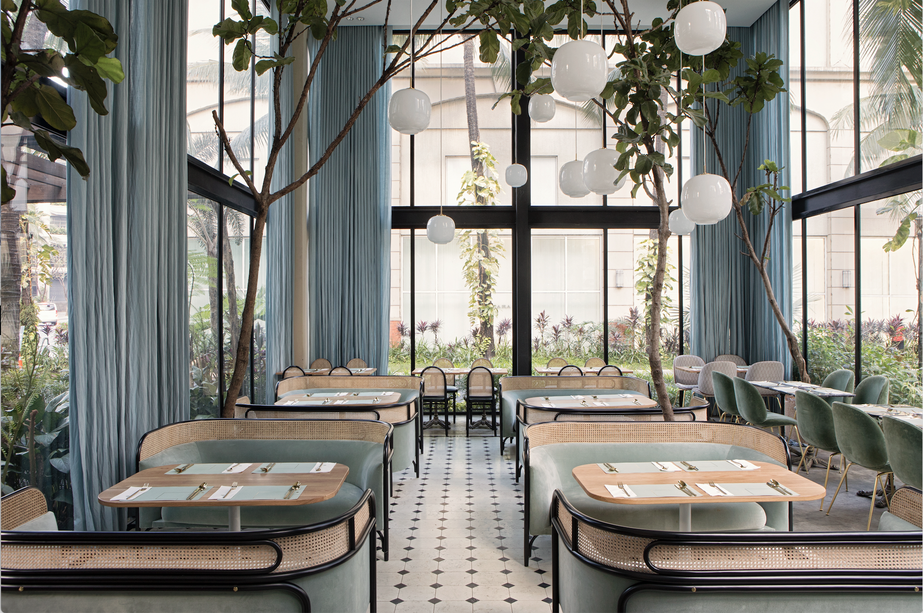 The Posh Povera 'Targa' and 'Morris' sofas by GamFratesi for Gebruder Thonet decorate the Harlan+Holden Glasshouse Café in Makati City, Philippines