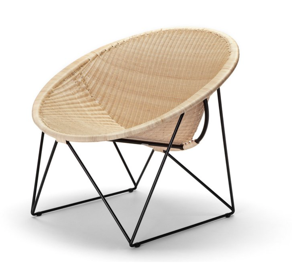 The 'C317' armchair in natural rattan and powder-coated steel. Designed in 1965 by Yuzura Yamakawa, £675, from SCP