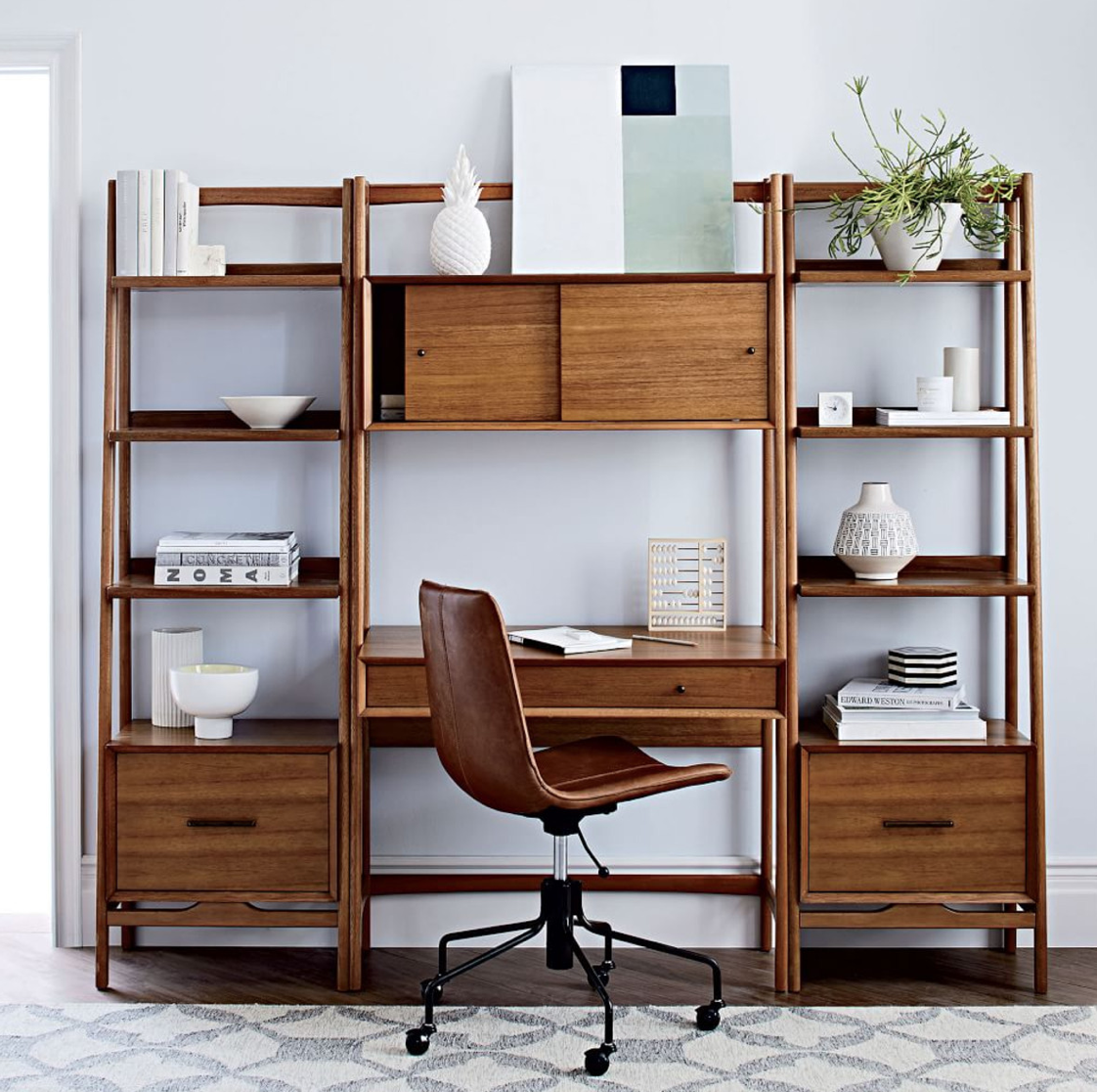 Solid wood 'Mid Century' style wall desk unit shown with a pair of bookshelf units, all from WestElm. Desk unit £599. Shelves £499.