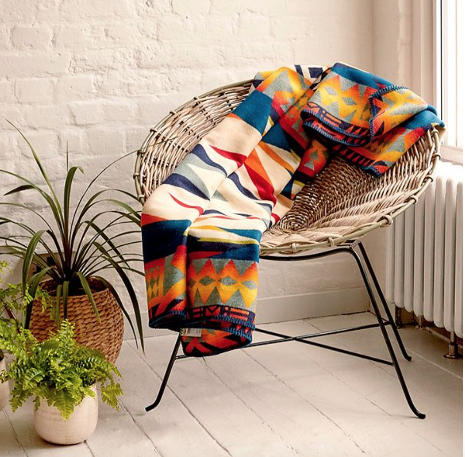 'Kubu' rattan armchair from Urban Outfitters, £350.