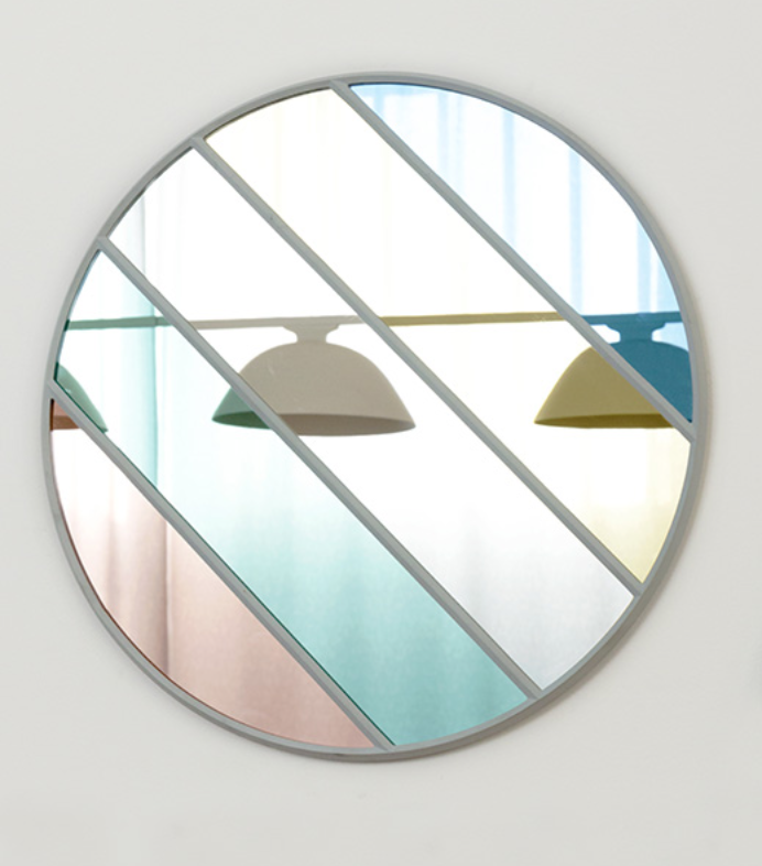One of a series of eight mirrors designed by Inga Sempé for Magis