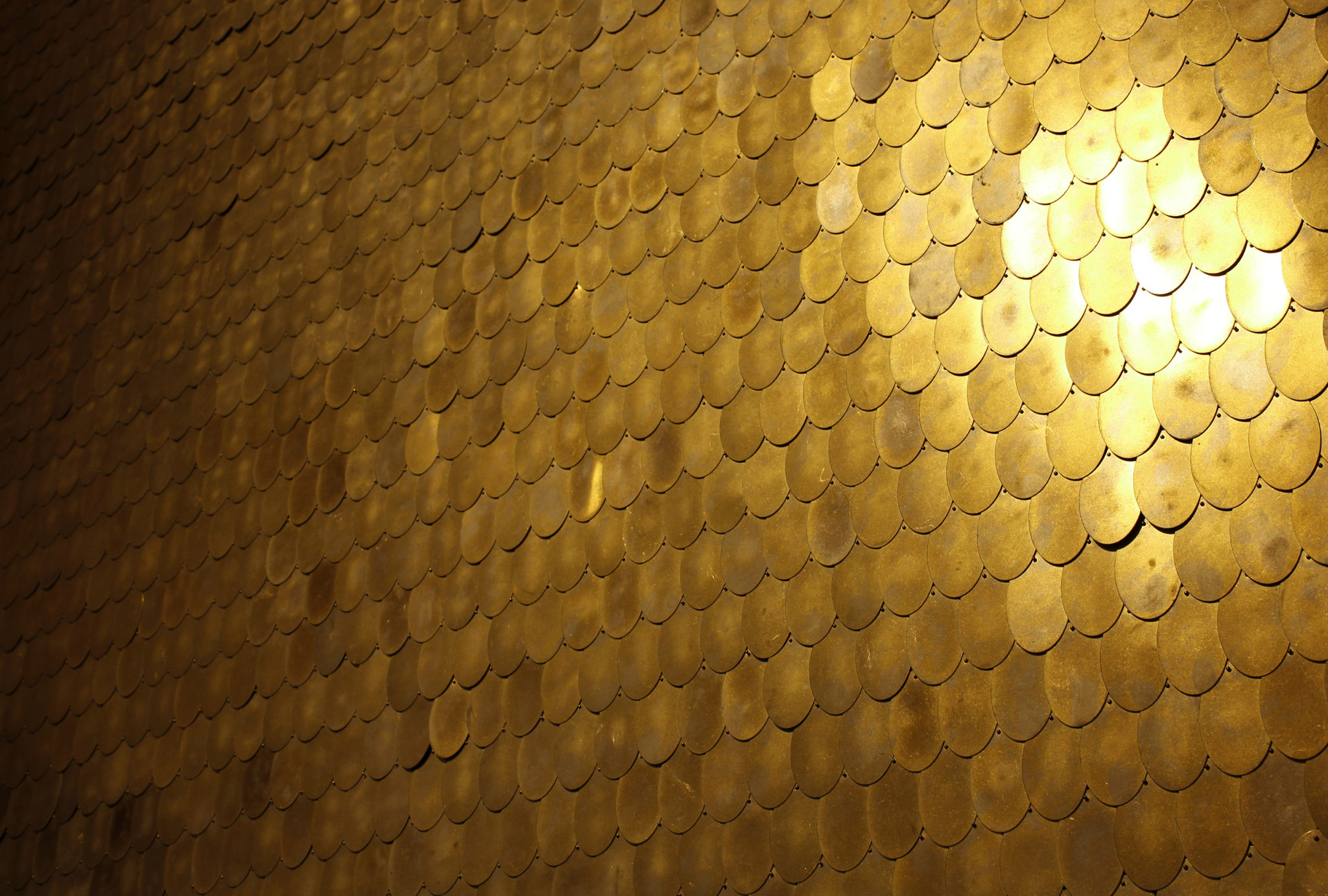 Brass 'sequin' tiles from the Shimmer Collection designed by Erica Tanov for Clé