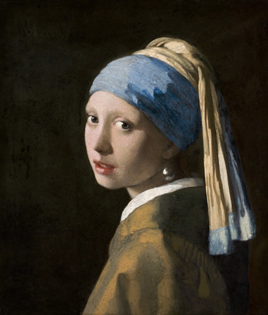 Girl with a Pearl Earring by Vermeer, painted in 1665. Head scarf in blue.