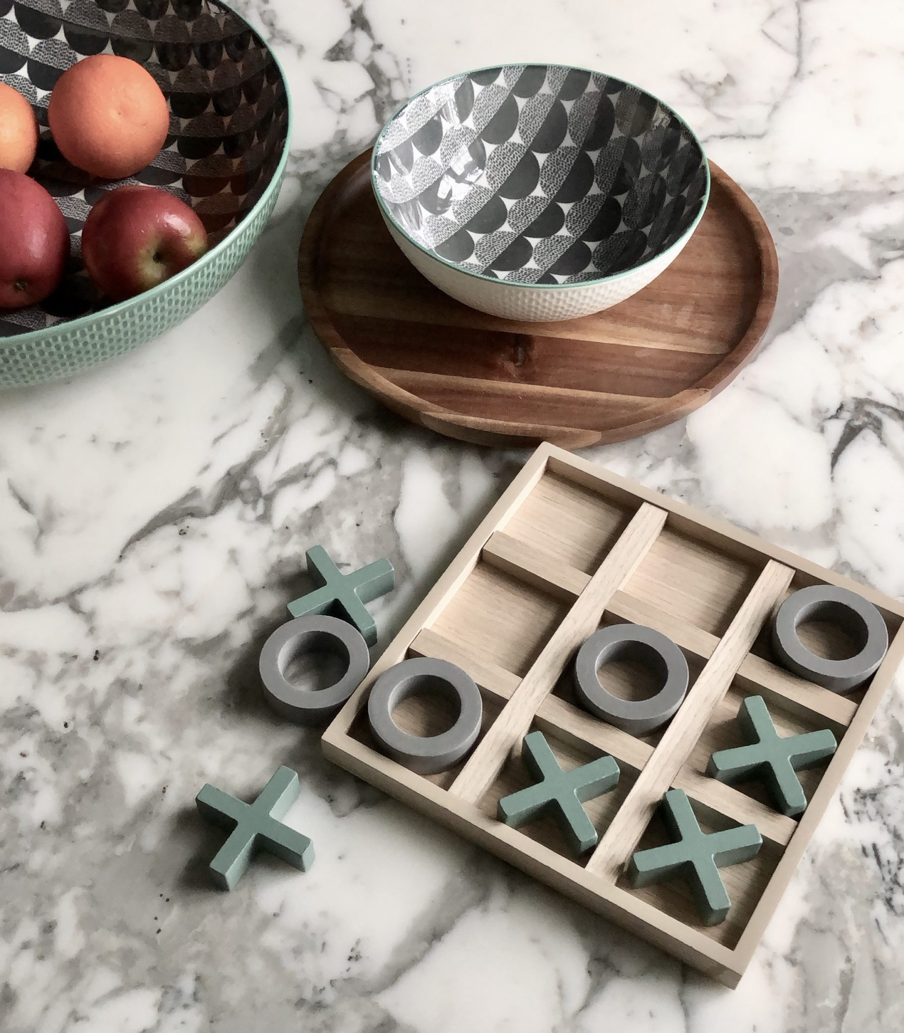 Fruit bowls, tray and noughts and crosses set, all from the Sainsbury's Home collection.